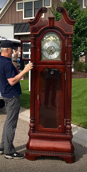 A Howard Miller Grandfather Clock after we repair it
